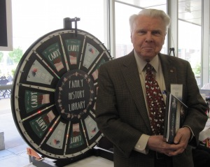 James Marion Baker spins the wheel at the BYU Family History Library booth and wins some chocolate!